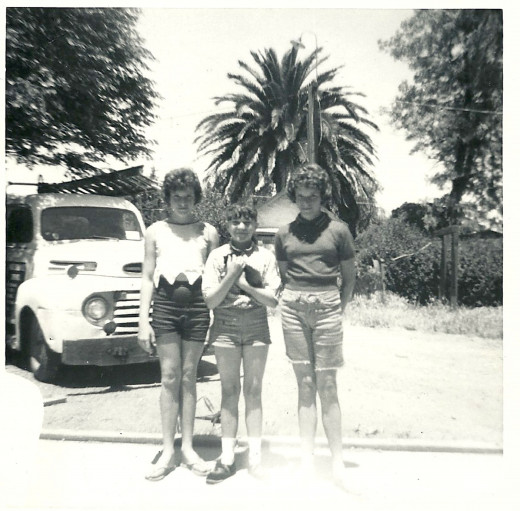 Photo of me between two friends at the age of 11.