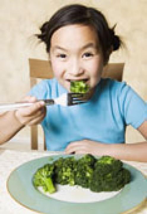 Young Asian Girl eating broccoli Blend Stock Photos