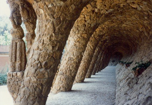 Retaining walls and sturdy supports for the roadway above in Guell Park
