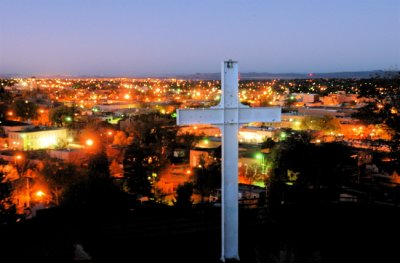 The cross at Ft. Marcy Park with view of downtown Santa Fe.