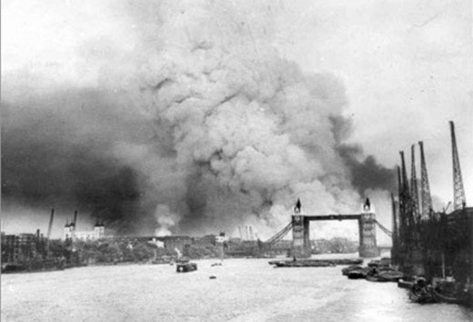 Bombing of Bermondsey and London during the Blitz, showing the aftermath of an air raid over the Thames and Tower Bridge.