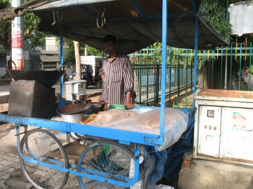 Hot Chips on Sidewalk.No check by Health Dept,No Law for these 4 wheel Junk food Eateries.Sold right under traffic police,when he has occupied sidewalk meant for pedestrians.