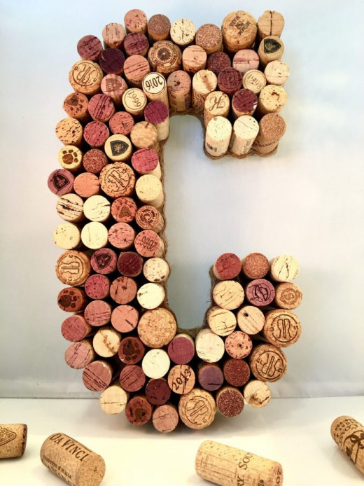 Just glue some wine corks on an initial letter to create a unique decor piece