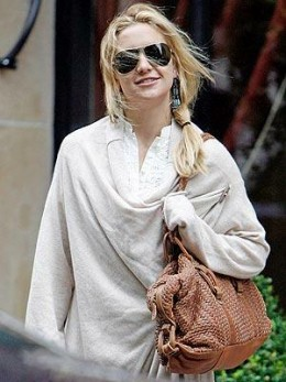 Kate Hudson totes her spacious Village Weave Dome satchel by Cole Haan for running errands in L.A. and shopping in Paris.