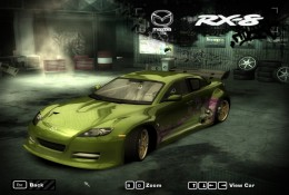 Green Mazda RX-8, parked, frontal view.