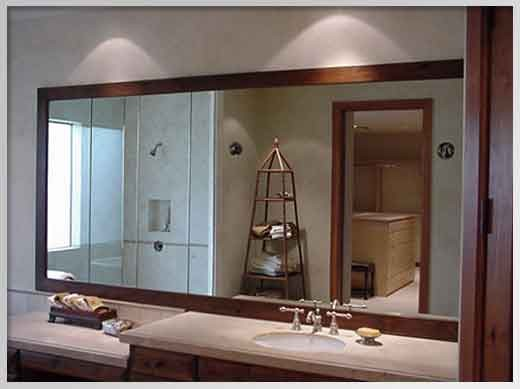 A massive, framed bathroom mirror sets off the entire room