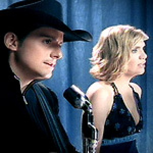 "Brad Paisley and Alison Krauss sing ""whiskey Lullaby"""