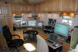 This custom made factory fifth wheel RV that was ordered to specifically work while living on the road.