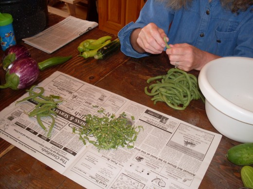 Snap the ends off the beans, and remove strings as necessary. Break into pieces, if desired. If you like eating whole green beans, leave them whole.