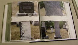 Page in a photo album with pictures of my great-grandparents grave markers.