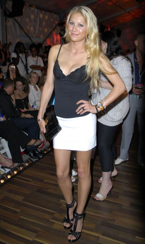 Anna Kournikova in a short white skirt and high heels