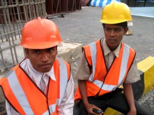 These boys in heavy construction Govt work wearing Helmets with out ISI mark a punishable offence but no asker.