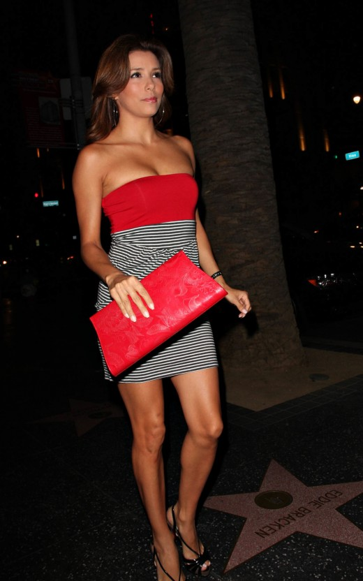 Eva Longoria in a short tube dress and high heels