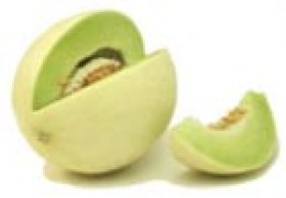 Honeydew melon with a segment removed