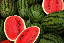 Whole and halved watermelon.