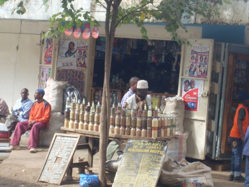 Traditional healer selling his medicines on the street