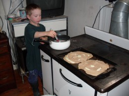 My son, six, preparing soup to go with our quesadillas. (We're using a wood-or-coal cookstove.)