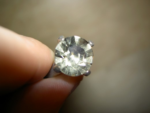 While it might be difficult for the untrained eye to tell the difference between a real diamond or a good fake, synthetic or lab diamonds are real diamonds, so not even experts can tell.
