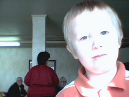 Travis scopes out my webcam one morning before church.