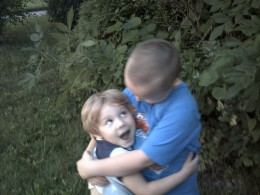Travis and Loree share a hug.  She loves her big brothers.