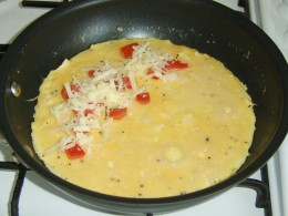Cheese and Tomato Filling added to Omelette