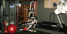 Basement home gym purchased at www.precorhomefitness.com