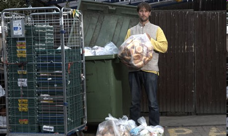Eco-activist Tristram Stuart demonstrates how much food waste is created by supermarkets like Tesco. Photograph: from The Guardian - Andy Hall