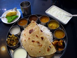 A Vegetarian South Indian Lunch with curd and buttermilk serving