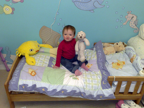 Happy toddler in under water theme bedroom