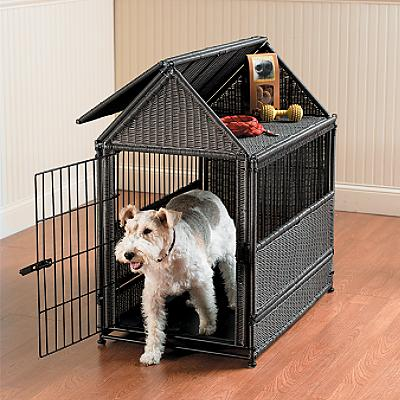 This stylish wicker dog crate includes storage for supplies.