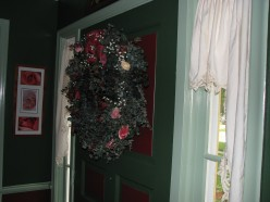 The front door; adorned with eucalyptus wreath and real dried roses.