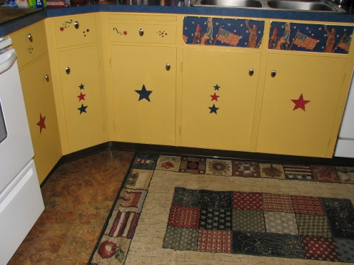 The lower cupboards with the stenciled stars