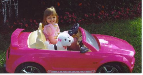 This is a pink barbie coloured power wheels ford mustang. It has tremendous quality for the best driving for your child. Seats 2 kids and 5 stuffed animals may be able to fit in. :)