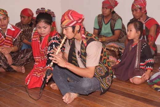 A T'boli youth plays the bamboo flute to mark the beginning of a cultural presentation.