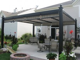 Fixed patio canopies like this with movable shade elements are a great choice.  Photo by http://www.flickr.com/photos/shadetree_canopies/3792247325/