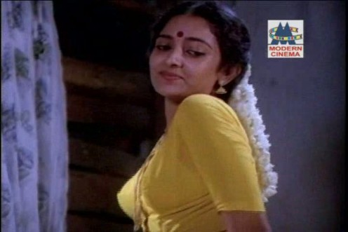 Tamil old Actress Removing saree blouse photo Image 0