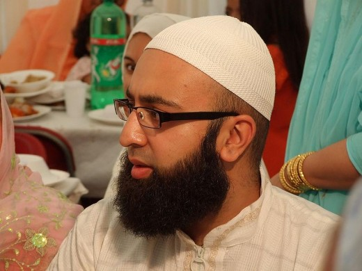 Muslim man in the UK with beard, glasses and prayer cap. Source:  Nikah 018 at Flickr courtesy of Wikimedia Commons.