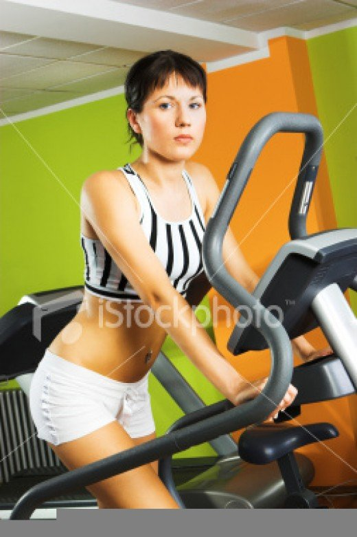A young girl working out at a gym