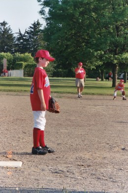 At 3 learning to play T-ball