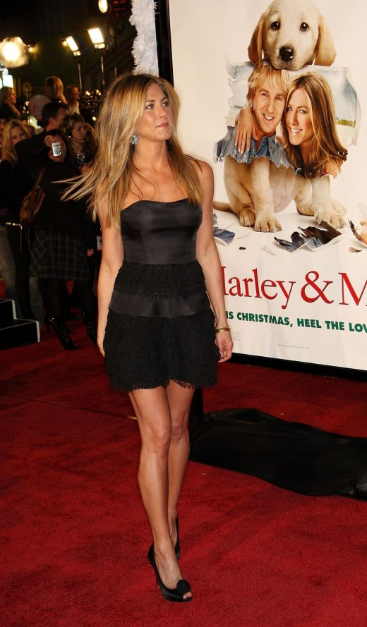 Jennifer Aniston in a short black strapless dress displaying her gorgeous legs in high heels