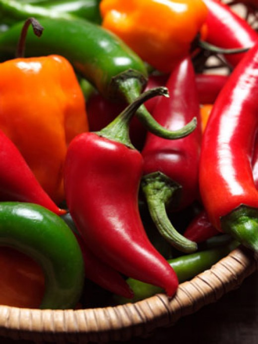 A colorful basket of peppers makes a great centerpiece for your table!