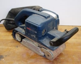 A belt sander uses a loop of cloth backed sandpaper and is very useful for aggressive stock removal. Image credit: http://en.wikipedia.org/wiki/File:Belt_sander_bosch.jpg