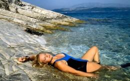 A sweet girl sunbathing at a Goa beach