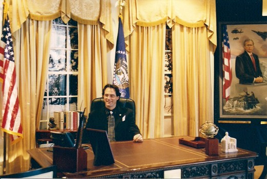 OUR MODEL IN THE OVAL OFFICE WEARING A BLACK ARMANI SUIT