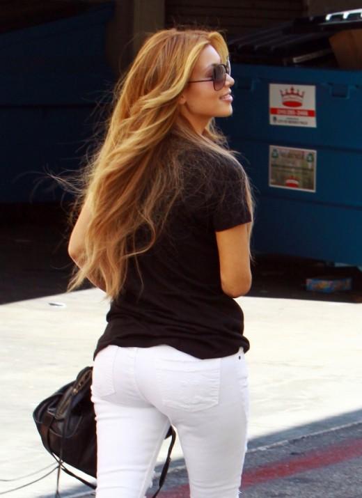 Kim Kardashian in white skinny jeans running errands in Hollywood