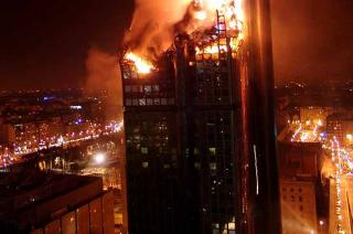 """A """"towering inferno"""" -- the kind that present a special challenge and greater danger to fire departments throughout the world."""