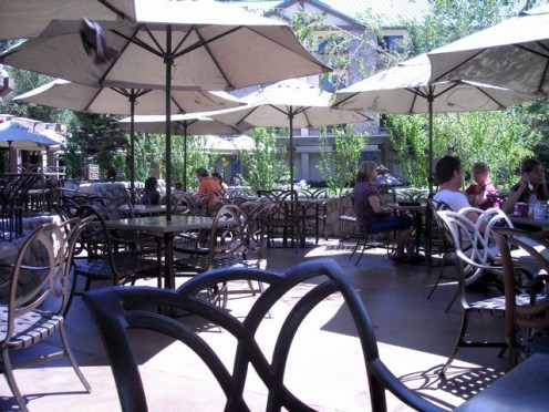 The garden patio is a pleasant place for lunch. (Note bird zooming under the umbrellas upper left.)