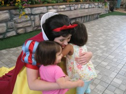 "This was the first time my girls ""met"" Snow White at Disneyland. This picture melts my heart!"