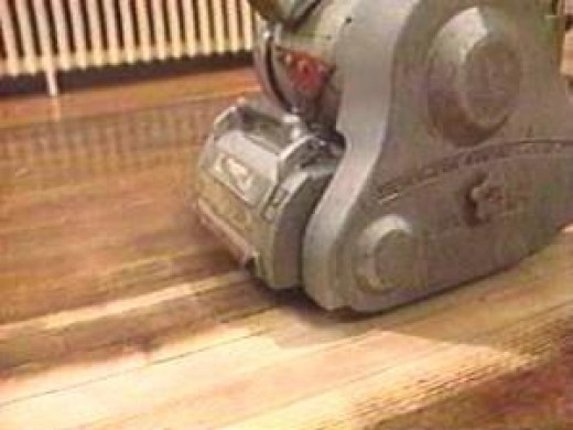 Using a drum sander. Image:doityourself.com - Step By Step Illustrated Guide To Refinishing Wood Floors Dengarden
