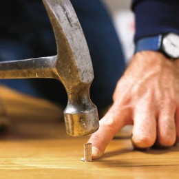 Use a small dowel to fill larger holes. Knock in with a hammer before sanding the floor. Image: David Carmack,ThisOldHouse.com